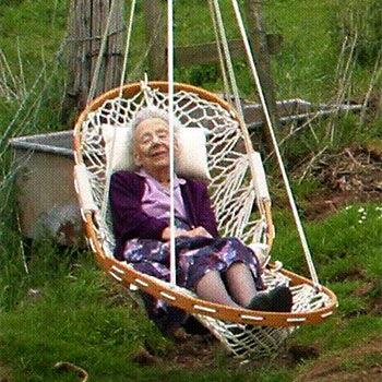 A woman dozes in an Original Cobble Mountain Chair