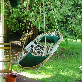 Our hammock chair hangs on a porch awaiting use